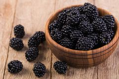 Blackberry. On a wooden table Stock Image