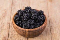 Blackberry. On a wooden table Stock Photos