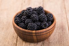 Blackberry. On a wooden table Stock Photography