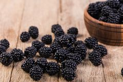 Blackberry. On a wooden table Royalty Free Stock Image