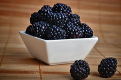 Blackberry in bowl Stock Photo