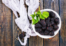 Blackberry. In the bowl and on a table Royalty Free Stock Photography