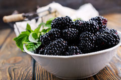 Blackberry. In the bowl and on a table royalty free stock images
