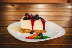 Blackberry cake slice. On a wooden table Royalty Free Stock Photos