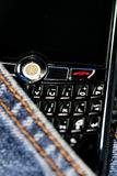 Blackberry cell phone 8820. The blackberry cell phone  with the jean background Royalty Free Stock Image