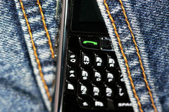 Blackberry cell phone 8820. The blackberry cell phone  with the jean background Stock Image