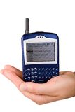 Blackberry cell phone in hand Royalty Free Stock Images
