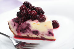 Blackberry cheesecake. Cheesecake with blackberry on a plate Stock Images