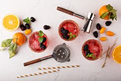 Blackberry citrus margaritas. With bartender tools overhead shot Stock Photos