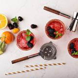 Blackberry citrus margaritas. With bartender tools overhead shot Stock Photo