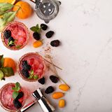 Blackberry citrus margaritas. With bartender tools overhead shot Royalty Free Stock Photography