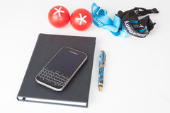 BlackBerry Classic smartphone and accessorizes. Moscow, Russia - February 1, 2015: BlackBerry Classic smartphone, notebook, pen and BlackBerry accessorizes Stock Photo