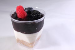 Blackberry dessert with cream cheese in cup Royalty Free Stock Images