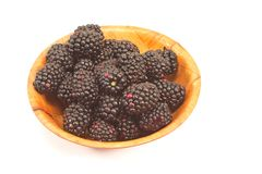 Blackberry fruit in  bamboo bowl isolated on white Royalty Free Stock Photos