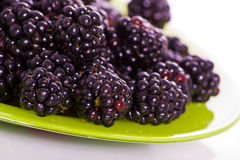 Blackberry on green plate. With small DOF Stock Images