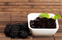 Blackberry jam and blackberries Stock Image