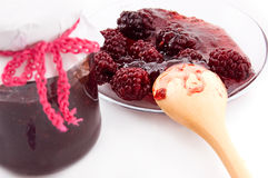 Blackberry jam in bottle and plate Stock Images