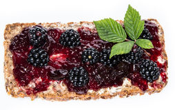 Blackberry Jam on a bread against white Royalty Free Stock Photos