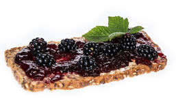 Blackberry Jam on a bread against white Stock Image