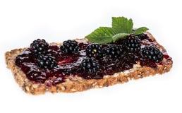 Blackberry Jam on a bread against white Stock Image