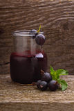 Blackberry jam. On broun wood stock photography
