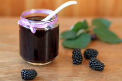 Blackberry jam. And fresh berries in wood Royalty Free Stock Image