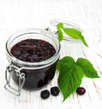 Blackberry jam and fresh blackberries Stock Photos