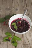 Blackberry  jam with a silver spoon Stock Photography