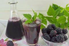 Blackberry juice with fresh blackberries served Stock Images