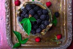 Blackberry with leaf in a basket on vintage metal tray. Top view. Blackberry with leaf in a basket on vintage metal tray. Top view Royalty Free Stock Images