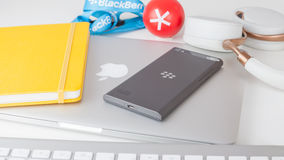BlackBerry Leap smartphone, Apple MacBook and accessorizes. Moscow, Russia - May 25, 2015: BlackBerry Leap back, Apple MacBook Pro Retina, Parrot Zik ear-flaps Stock Photo