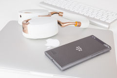 BlackBerry Leap smartphone and Apple MacBook Stock Photography