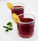 Blackberry lemonade. Glasses of blackberry lemonade on a old white wooden background Royalty Free Stock Photos