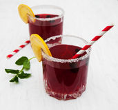 Blackberry lemonade. Glasses of blackberry lemonade on a old white wooden background Royalty Free Stock Image
