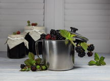 Blackberry in a metal mug with jam Royalty Free Stock Photos
