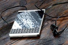 BlackBerry Passport on wooden table Stock Photos
