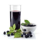 Blackberry in plate and glass juice Stock Image