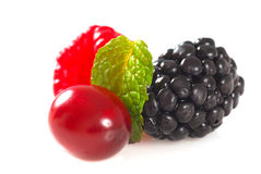 Blackberry, raspberry and cranberry with mint. Closeup of a blackberry, raspberry and cranberry with mint Stock Photo