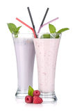 Blackberry and raspberry milk smoothie with mint. On white background Stock Photography