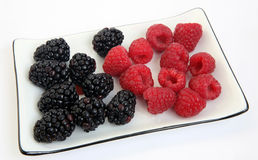 Blackberry and raspberry on a plate Royalty Free Stock Image