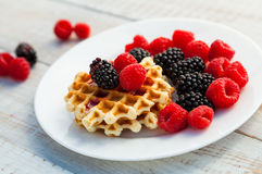 Blackberry and raspberry. With a waffle on a white plate Royalty Free Stock Photos