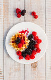 Blackberry and raspberry. With a waffle on a white plate Stock Photos