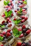 Blackberry and raspberry in the white yogurt. Royalty Free Stock Photo