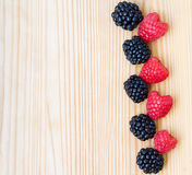 Blackberry, raspberry on wood, card Stock Photos