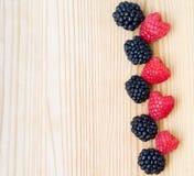 Blackberry, raspberry on wood, card Stock Photos