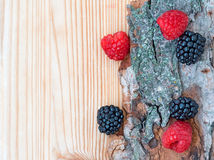 Blackberry, raspberry on wood, card Stock Photography