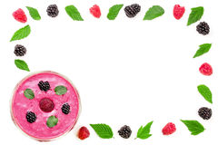 Blackberry and raspberry yogurt or smoothie isolated on white background with copy space for your text. Top view. Blackberry and raspberry yogurt or smoothie Stock Images