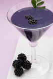 Blackberry shake in a cocktail glass royalty free stock image