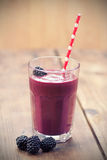 Blackberry  Smoothie. Fresh Blackberry  Smoothie on wooden table Royalty Free Stock Image
