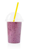 Blackberry smoothie in plastic transparent cup Royalty Free Stock Photo